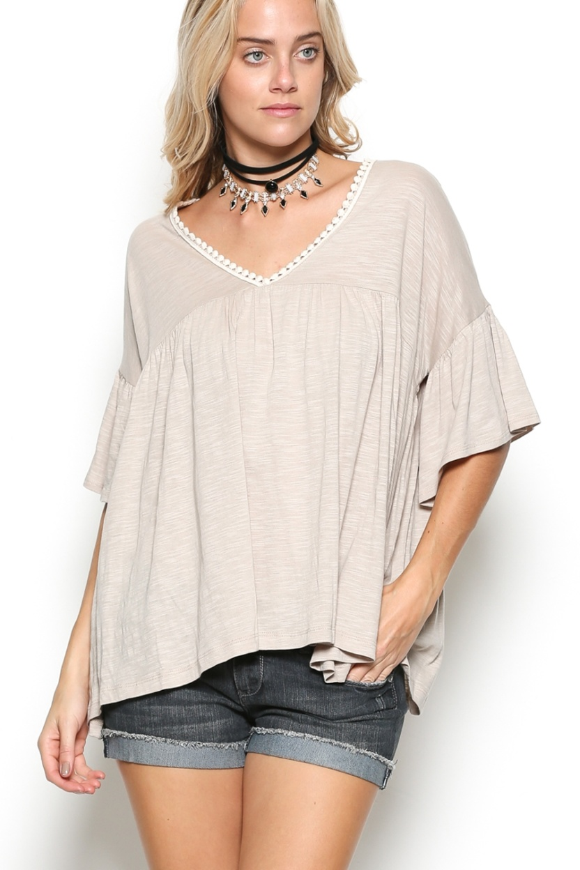 Oversize delicate casual ruffle tunic, V neckline with lace detail and half dolman sleeve with ruffle.