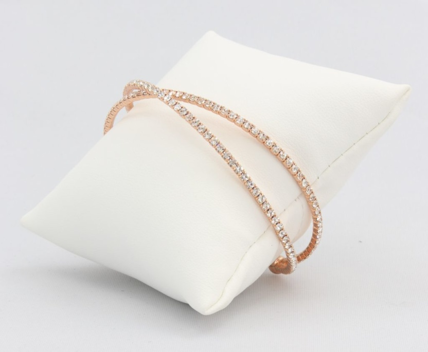 Criss-cross bracelet with inlaid simulated diamonds