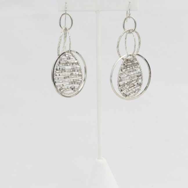 Hammered hoop earring with suspended teardrop pendent