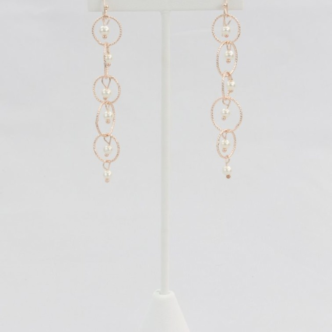 Rose gold linked hoop and pearl earrings