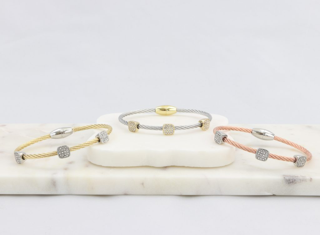 Twisted cable bracelet with square-housed synthetic diamonds