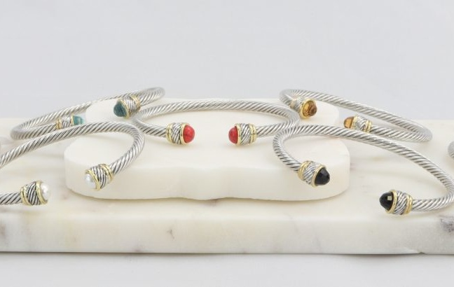Twisted cable cuff bracelet with gold inlay and colored gemstone