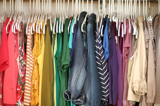 Clothes rack full of colorful clothing