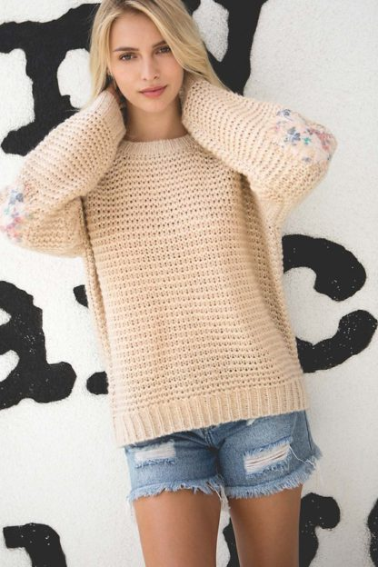 Basic ribbed pullover sweater with multi-colored floral elbow patch