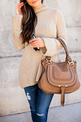 Tan purse with neutral-colored outfit