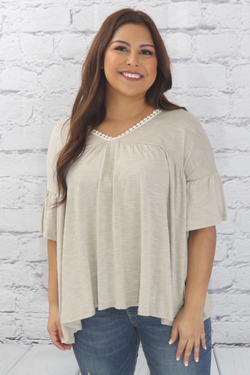 Casual ruffle tunic with lace detail and half dolman sleeve