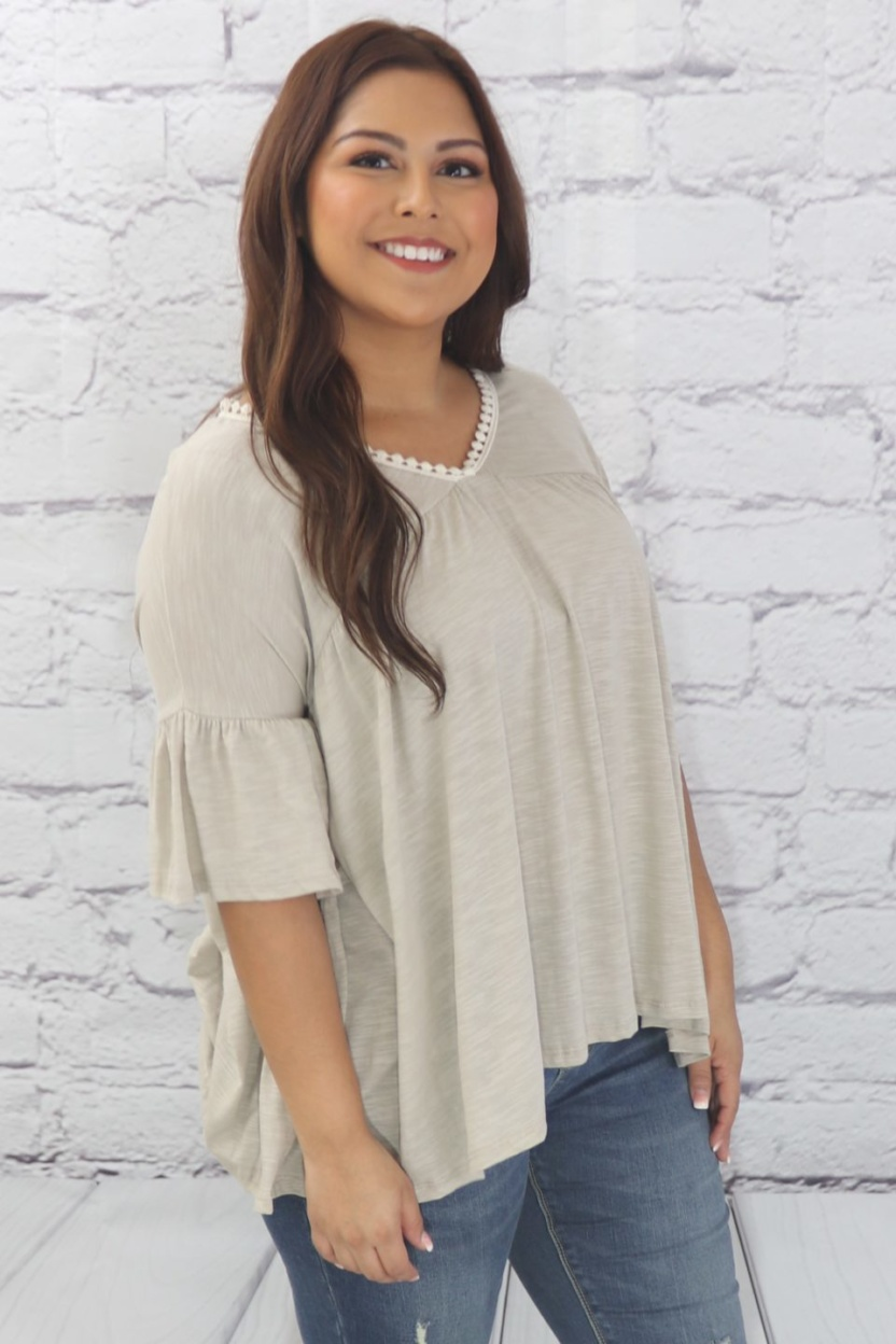 Casual ruffle tunic with lace detail and half dolman sleeve side view