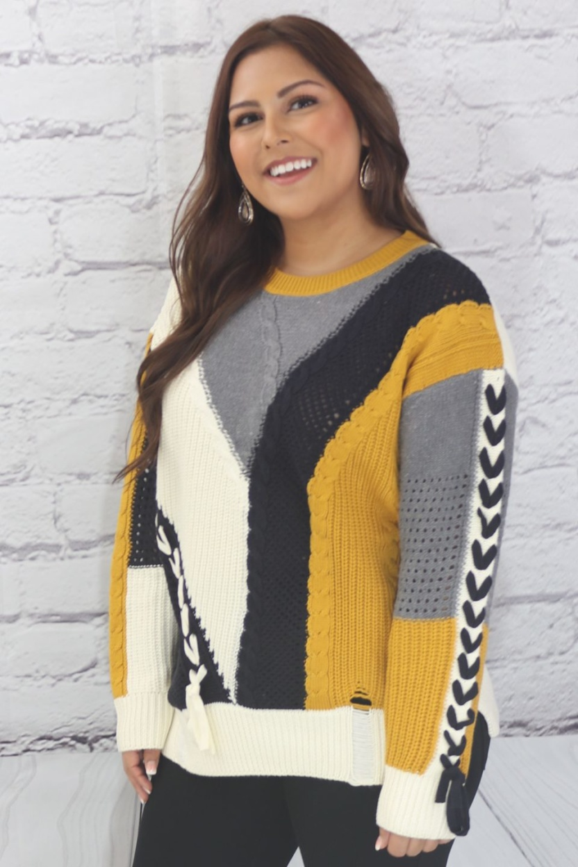 Long sleeve color block cable knit sweater with lace-up trim