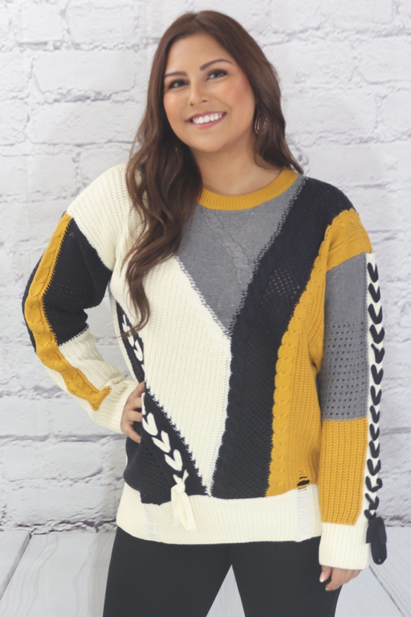 Long sleeve color block cable knit sweater with lace up trim
