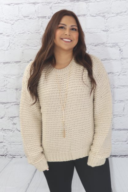 Ribbed pullover sweater with floral elbow patches