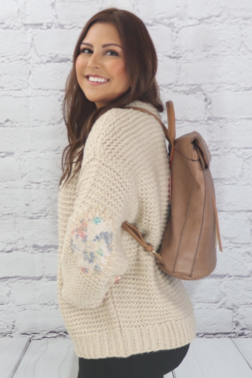 Ribbed pullover sweater with floral elbow patches side view