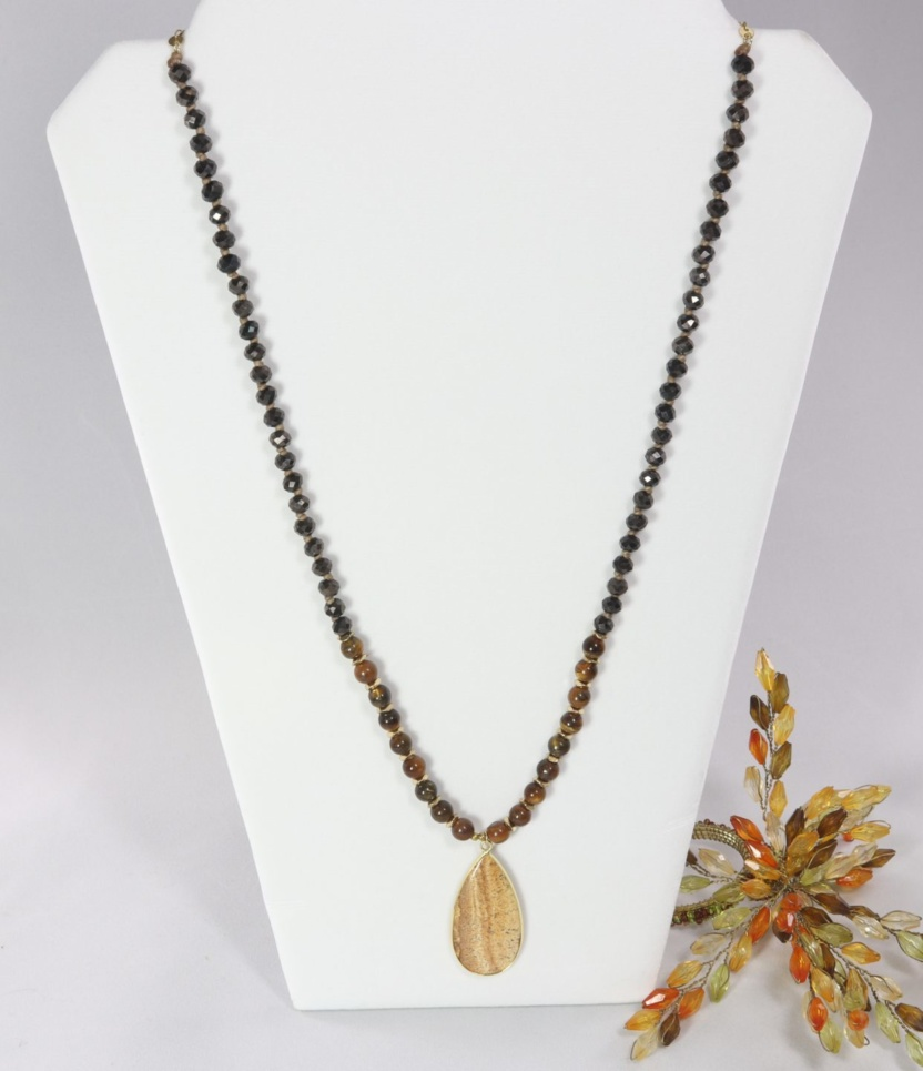 Earth-tone beaded necklace with polished stone pendant