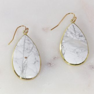 Gold hook earring with white long teardrop flat stone