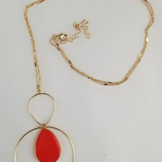 Red teardrop earring with golden ring trim