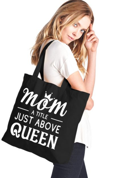 Mom a title just above queen canvas tote bag black hanging