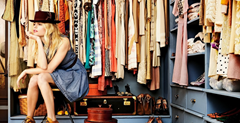 Woman in closet thinking