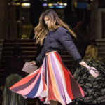 Colorful striped pleated skirt with black overcoat