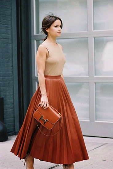 Dramatic flair of pleated skirt creates beautiful silhouette