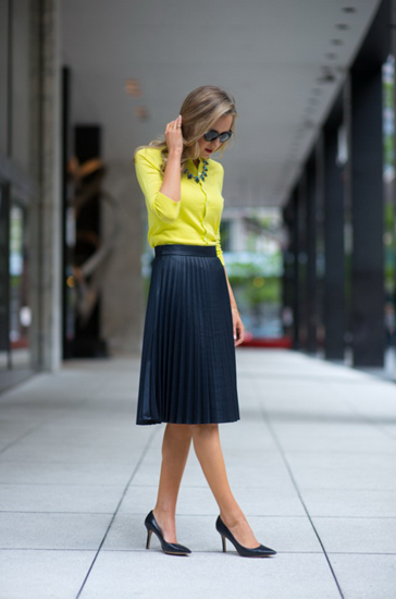 High rise knee length pleated skirt and neon yellow blouse