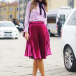 Hot pink pleated skirt with pink top and shoes