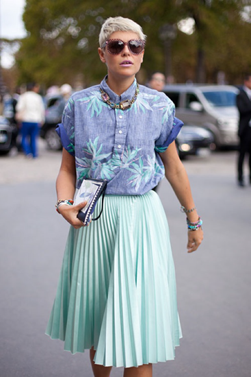 Impact of statement necklace with colorful pleated skirt outfit