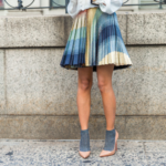 Muted colorful pleated mini skirt with matching socks