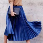 Neon blue pleated skirt with pumps