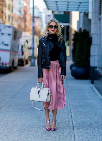 Pink pleated skirt with matching heels and edgy leather jacket