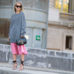 Pink pleated skirt with oversized sweatshirt and pumps