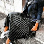 Pleated midi skirt with denim jacket and sneakers
