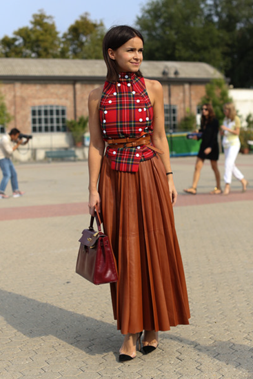 Pleated skirt with untucked shirt and cinched belt