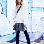 Striped pleated skirt with white overcoat and dark blue boots
