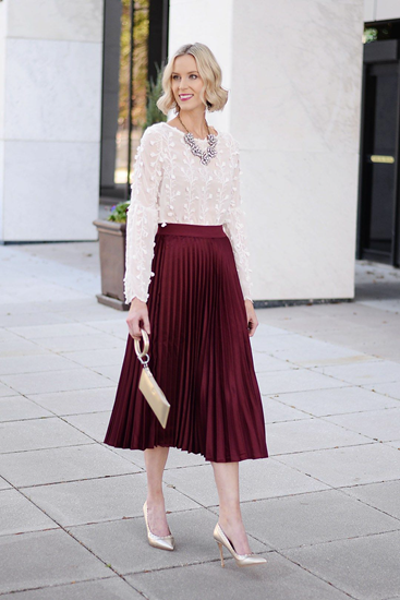 Wine pleated skirt with lace top and statement necklace and purse