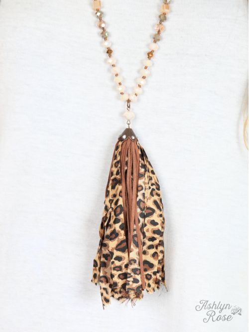 Lorraine's Leopard and Brown Leather Tassel Necklace close