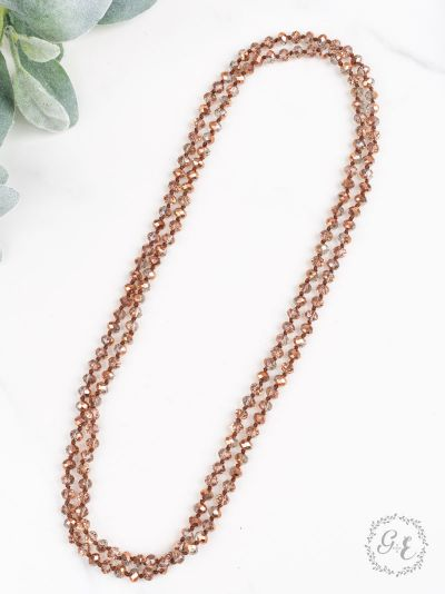 60-inch double-wrap beaded metallic rose gold necklace