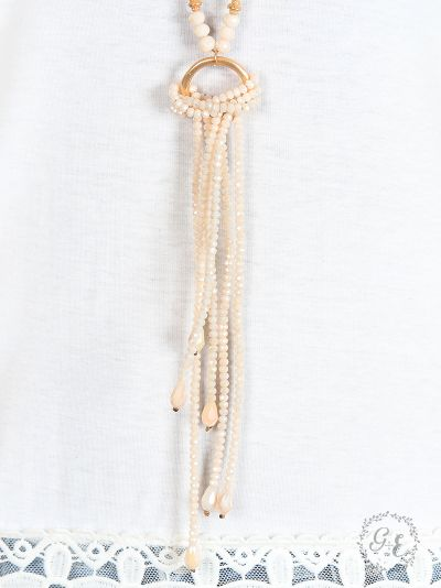 Elegant Ivory Beaded Tassel Necklace with Gold Ring Accent close