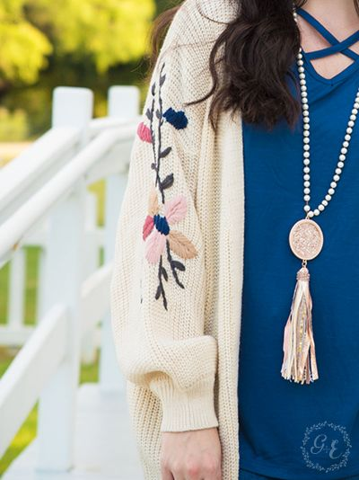 Thick knit cardigan with embroidered flower sleeves beige close