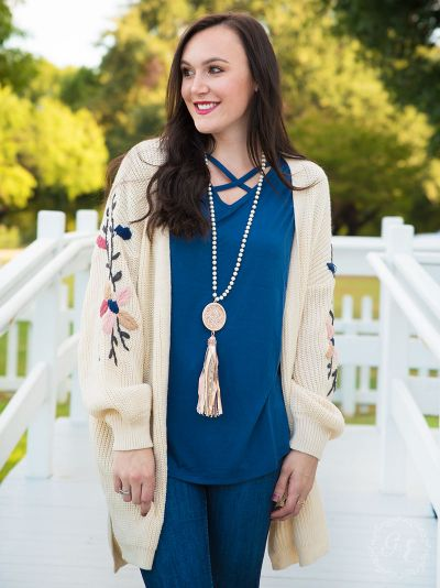 Thick knit cardigan with embroidered flower sleeves beige