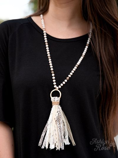 You're a charmer white snakeskin tassel necklace on model