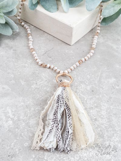 You're a charmer white snakeskin tassel necklace