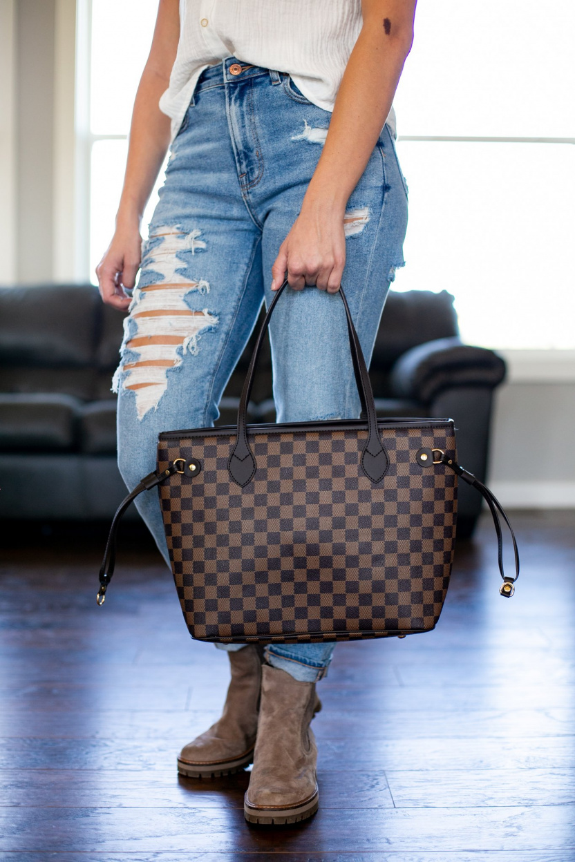 Lacey Totes Purse and Wristlet Brown in hand