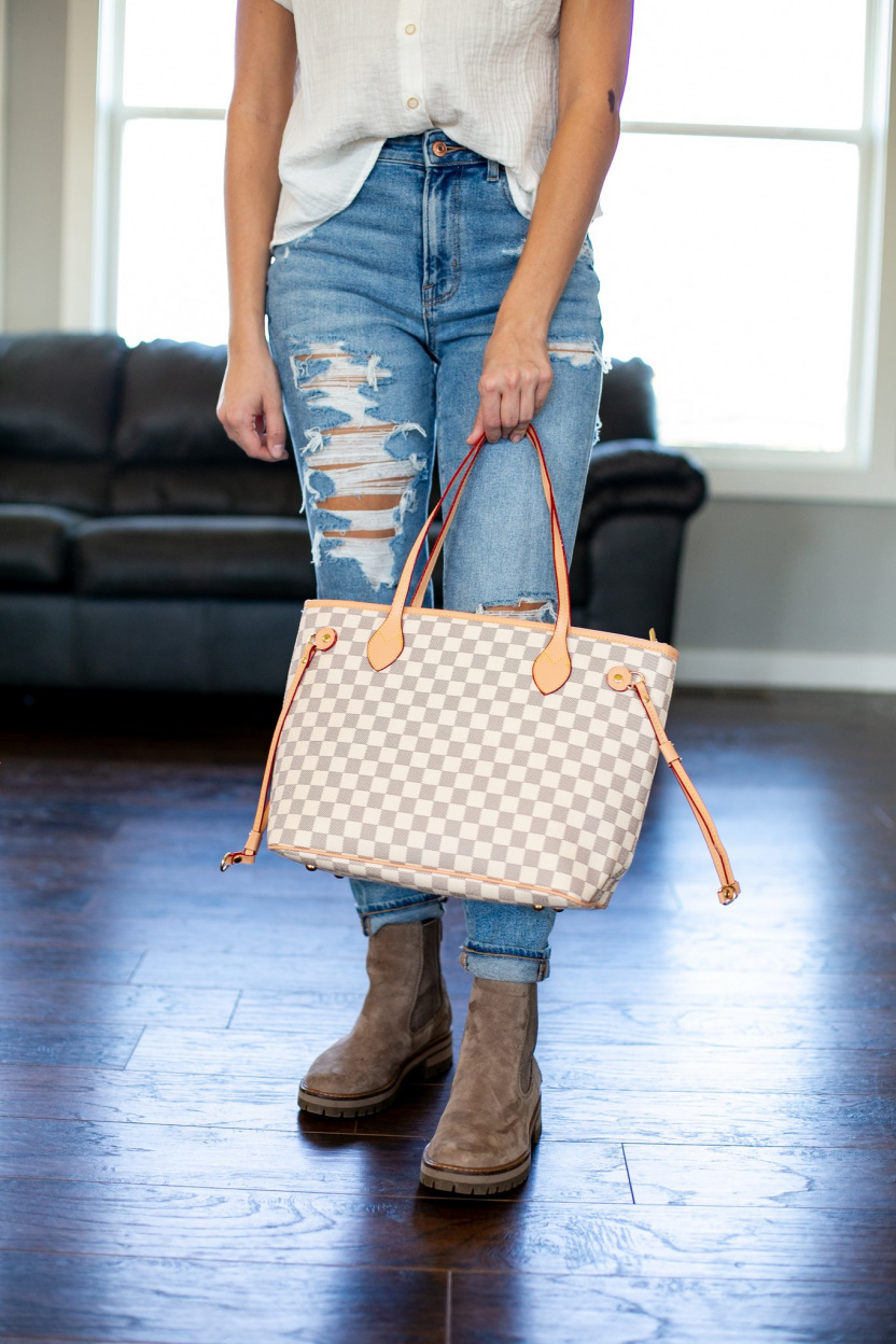 Lacey Totes Purse and Wristlet cream in hand