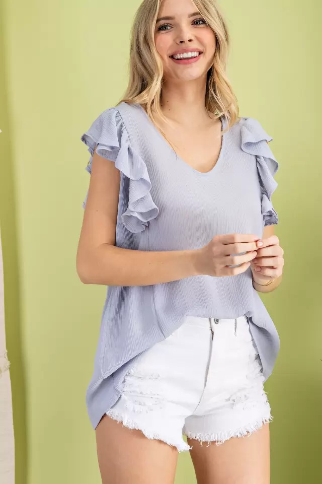 Sleeveless ruffle V-neck woven blouse silver blue front hands