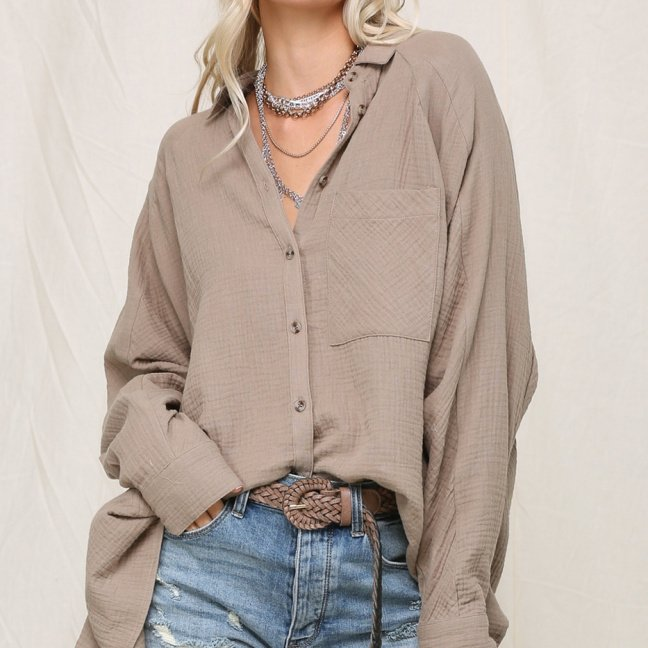 Crinkly lightweight button down featured in an oversized silhouette with single pocket taupe front